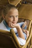 Portrait of a girl. Portrait of Caucasian pre-teen girl with chin in hand looking at viewer stock image