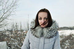 Portrait of a girl. Girl on the background of a winter landscape Stock Photos