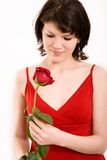 Portrait of a girl. The girl in a red dress with a rose royalty free stock photo