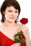 Portrait of a girl. The Portrait of the girl with a rose in hands royalty free stock images