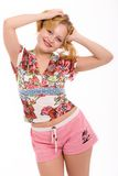 Portrait of a girl. The beautiful blonde in sportswear smiles royalty free stock images