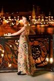 Portrait of girl against night city Stock Photos