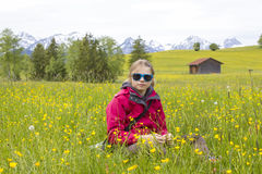 Portrait of a girl against the panorama of the Alps Stock Images