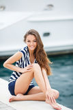 Portrait of the girl against the sea and yachts Royalty Free Stock Photography