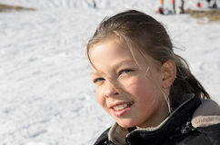 Portrait of girl against the snowy slope Royalty Free Stock Photos