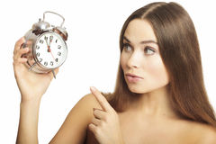 Portrait of the girl with an alarm clock Royalty Free Stock Images