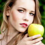 Portrait of a girl with an apple Stock Photo