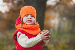 Portrait of a girl with an apple stock image
