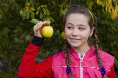 Portrait of girl with apple Stock Image