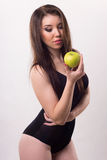 Portrait of a girl with an apple. Stock Photo