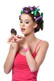 Portrait of a girl applying lipstick Stock Photos