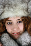 Portrait of girl in arctic fox cap royalty free stock photos