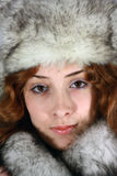 Portrait of girl in arctic fox cap Royalty Free Stock Image