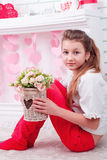 Portrait of girl with artificial flowers Royalty Free Stock Photography