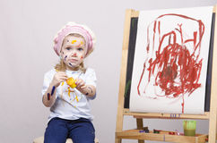 Portrait of a girl artist at the easel Royalty Free Stock Photography