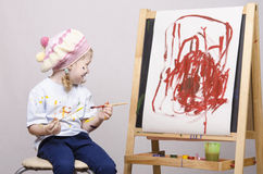 Portrait of a girl artist at the easel Stock Photos