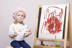 Portrait of a girl artist at the easel Stock Images