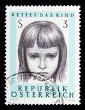 Portrait of a girl, Austrian Organisation Save the child serie. MOSCOW, RUSSIA - MAY 13, 2018: A stamp printed in Austria shows Portrait of a girl, Austrian Stock Image