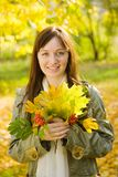 Portrait of girl with autumn bouquet Royalty Free Stock Photo