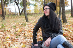 Portrait of a girl in the autumn forest Stock Photos