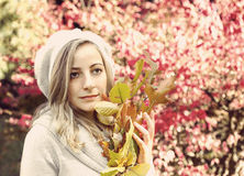 Portrait of a girl with autumn leaves Stock Photo