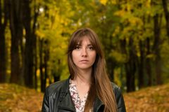 Portrait of a girl in an autumn park Stock Photo