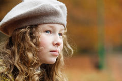 Portrait of girl in autumn park. Horizontal portrait of blond girl in grey beret in an autumn park Stock Photography