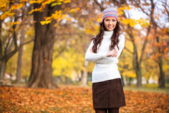 Portrait of girl in autumn park. Young woman in autumn park, posing in season clothing stock image