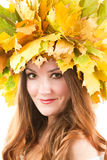 Portrait of girl with autumn wreath of maple leave Stock Image