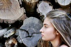 Portrait of the girl on the background. Of tree cut Royalty Free Stock Image