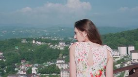 Portrait of a girl on the background of a city in the mountains stock footage