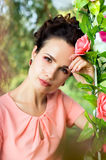 Portrait of a girl on a background of flowers Stock Photos