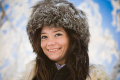 Portrait of a girl in the background of snowy bran. Сгеу Portrait of a girl in the background of snowy branches Stock Photos