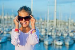 Portrait of a girl in the background of yachts Royalty Free Stock Photo