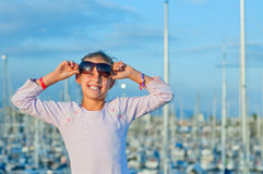 Portrait of a girl in the background of yachts. Closeop Portrait of a cute girl in the background of yachts Royalty Free Stock Photos