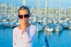 Portrait of a girl in the background of yachts. Closeop Portrait of a cute girl in the background of yachts Royalty Free Stock Image