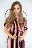 Girl with a badminton racket. A portrait of a girl with a badminton racket Royalty Free Stock Photo