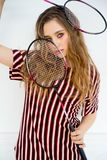 Girl with a badminton racket. A portrait of a girl with a badminton racket Stock Image