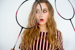Girl with a badminton racket. A portrait of a girl with a badminton racket Royalty Free Stock Images