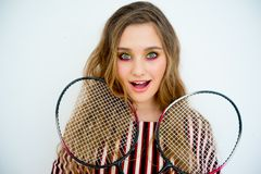 Girl with a badminton racket. A portrait of a girl with a badminton racket Royalty Free Stock Photography