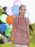 Portrait Of Girl With Balloons Smiling Royalty Free Stock Photos