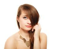 Portrait of girl with bang covering eye in golden necklace Royalty Free Stock Photos