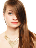 Portrait of girl with bang covering eye in golden necklace Stock Photography