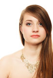 Portrait of girl with bang covering eye in golden necklace Royalty Free Stock Image