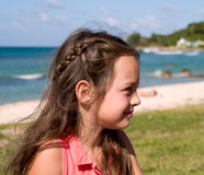 Portrait of girl on beach. Side portrait of young girl with beach in foreground Royalty Free Stock Photo