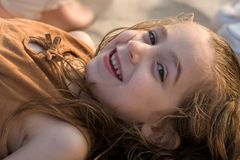 Portrait of girl on beach. Close-up of happy young girl reclining on beach Royalty Free Stock Image