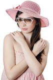 Portrait of the girl in a beach hat Stock Image