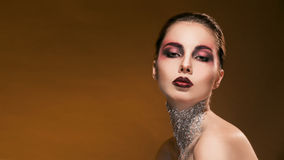 Portrait girl with beautiful makeup and silver on Royalty Free Stock Photo