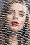 Portrait of girl behind net she is in front Stock Photos