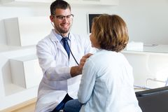 Girl being examined with stethoscope by pediatrician in the office. Royalty Free Stock Photos